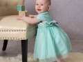 Preschool_Photograph_baby_standing_with_blocks